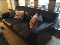 2 x 4 seater brown leather sofas.