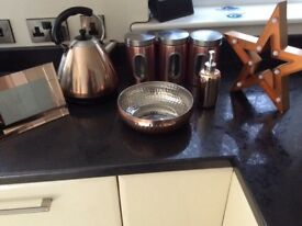 Copper kitchen accessories, kettle, tea, coffee and sugar, bowl, hand soap, picture frame, light