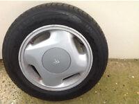 set of 4 genuine citroen zx volcane alloy wheels
