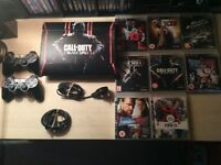 PlayStation 3 Console With 2 controllers and 8 Games. Pick Up Only.