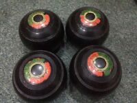 Set of 4 black bowling balls. Thomas Taylor Lignoid size no 2