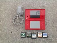 Nintendo dsi with five games
