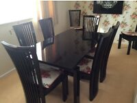 Black Italian Glass Topped Extendable Table with 10 chairs seats 6 to 10