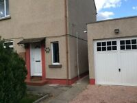 Two bedroom semi-detached villa unfurnished with garage and large back garden for rent