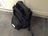 Black backpack, make is Targus. Lots of compartments.