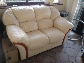 Cream leather two seater sofa,age related marks but good condition,buyer to collect.