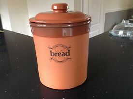 CIRCULAR TERRACOTTA BREAD CROCK WITH WORDED DETAIL