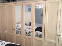 Fitted wardrobes plus 2 bedside cabinets to match