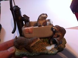 6 inch ornament . otters at play in belfast sink