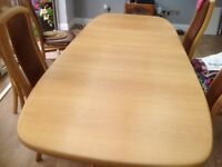 Dansk dining table and 6 chairs