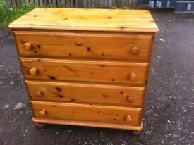 Solid pine four drawer chest of drawers in solid and sturdy condition