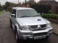 Mitsubishi L200 Warrior d cab colour coded MOT 145k drives great