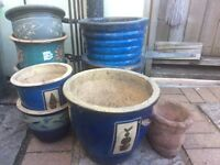 Lot of glazed stone garden pots and boot pot holder