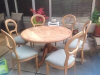 Solid pine circular dining table and chairs for sale.