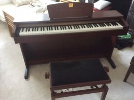 Yamaha Clavinova CLP-320M. Like new. Stool included.