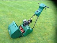 Qualcast petrol lawn mower.