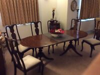 A Classical English mahogany dining table and 6 chairs