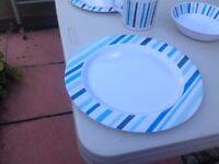 4 piece blue/ navy stripped melamine dinner set excellent condition .