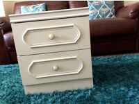Two matching white bedroom cabinets.2draws each.