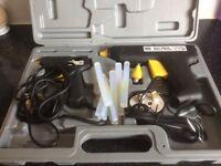 Glue guns and sticks in box