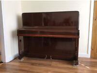 B. Squire upright piano