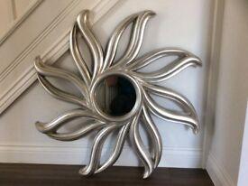 Unusual silver mirror