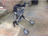 Four wheeled light weight fully compact mobility walker