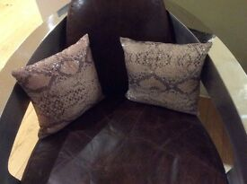 Faux animal print sequinned cushions