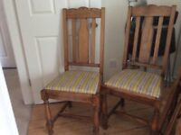 4 solid oak dining chairs.