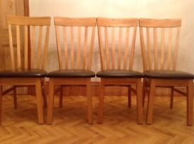 4 beautiful solid oak and leather dining chairs - barely used and in excellent condition!