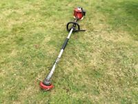 Kawasaki TH26 petrol straight shaft grass strimmer Good clean condition.