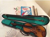 Violin half size c/w case and bow, 3 tutor books, shoulder rest and music stand