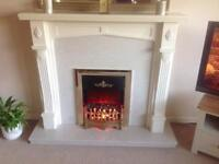 Fireplace marble surround and electric fire