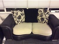 Sofa 2 + 2 black leather and fabric, great condition.