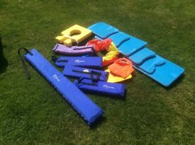 Large bag of swimming aids for children and adults.