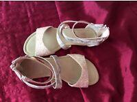 Girls gold sandals.