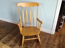 Classic wooden rocking chair, originally John Lewis, ideal for nursing a newborn