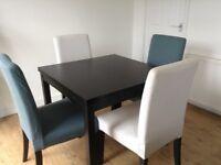 Black square IKEA extendable table
