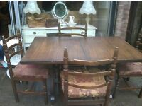 SOLID WOOD DINING TABLE FOUR CHAIRS.