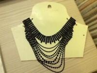 Woman's necklace, black bead, new, cascading design. New look