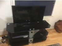 Near new TV with stand for sale