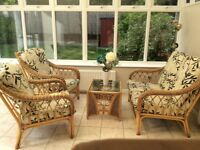 Conservatory furniture. Two seater wicker sofa and two chairs with matching glass table