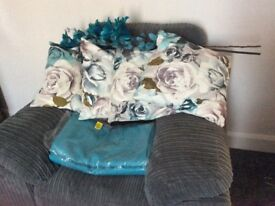 A pair of Teal Blackout Curtains and 4 Cushions