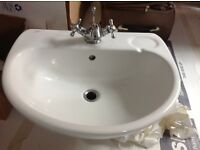 Wall mounted porcelain basin and traditional tap included - good condition