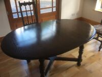 ERCOL OVAL DINING ROOM TABLE AND SIX CHAIRS