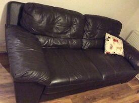 2 x brown leather three seater sofas