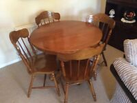 Dark oak wood dining table and chairs