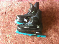 Bauer Ice hockey skates for sale, blade guards and unused since having been sharpened.