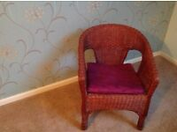 Whicker chair. In excellent condition. In natural wood finish.