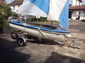 Sailing dinghy, road trailer and launching trolly. Ideal to learn in or family fun days.